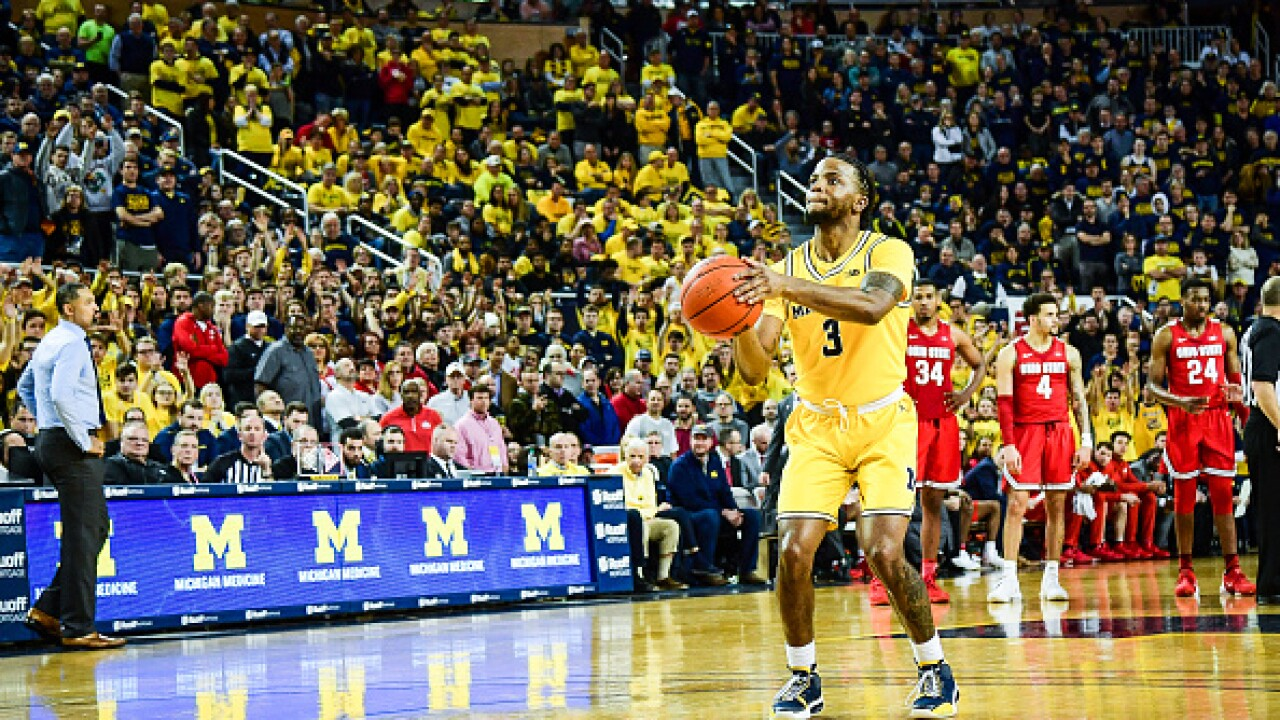 Review in final minute lifts Ohio State past Michigan