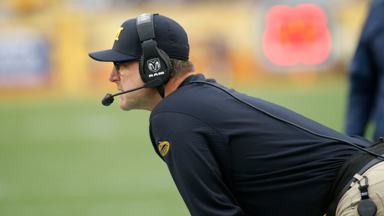 You could be Jim Harbaugh's assistant at Michigan