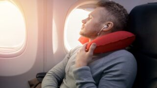 We've Been Wearing Travel Pillows Wrong This Whole Time