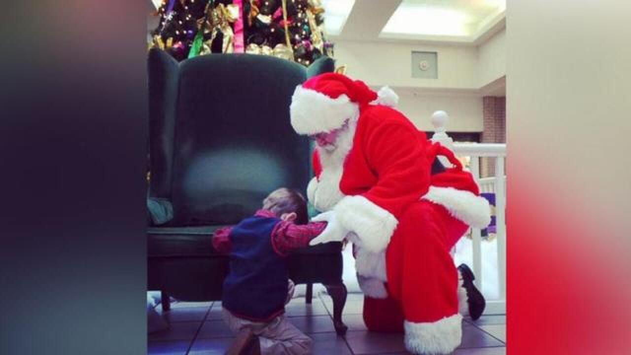 Photo of Boy Praying With Santa Steals Hearts