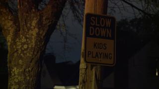 slow_down_sign_dark.jpg