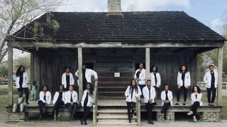 Black med school students pose for photo at plantation to show how the past inspired their future