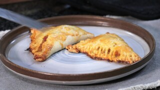 The plated cheesy beef empanadas fresh from the oven.
