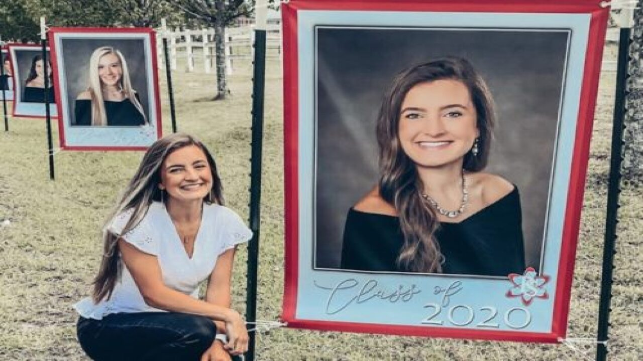 A Principal Decorated Her School's Driveway With Huge Senior Photos To Honor Graduates