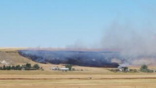 Fire burns near homes on Bootlegger Trail