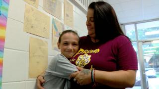 Nicole Martone hugs student