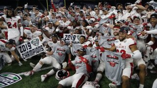 Miami of Ohio team pose on the field after the Mid-American Conference championship