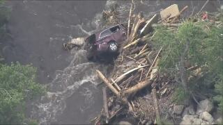 poudre canyon flash flood damage car.jpg
