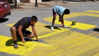Community members help clean up vandalism on Black Lives Matter mural