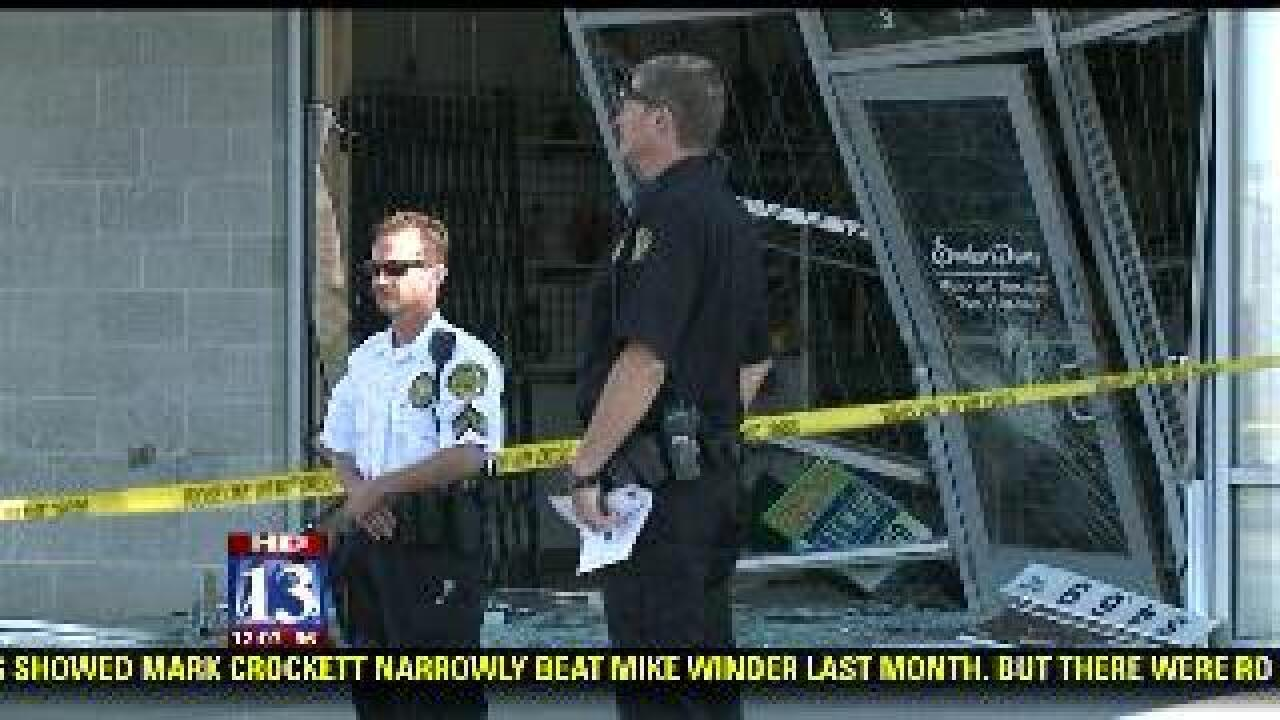 Robbery suspect crashes into Roy smoke shop with cab of semitrailer