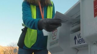 Ballot getting dropped off at a secure ballot drop box in El Paso County.