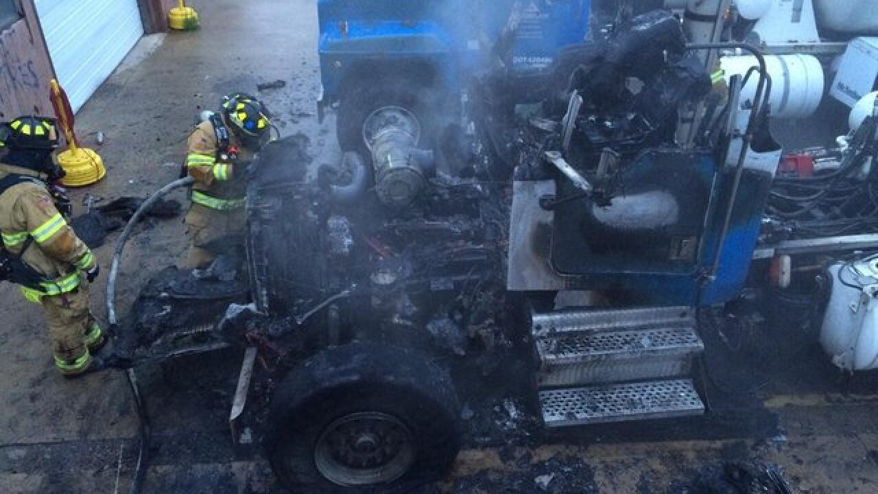 Fire burns concrete truck