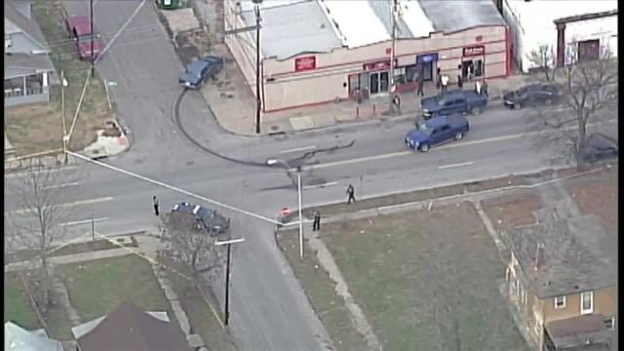 KC police witness rolling gun battle on street
