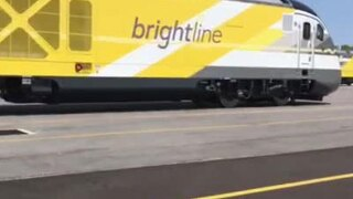 Truck ignores crossing signals, narrowly avoids being hit by train in Florida