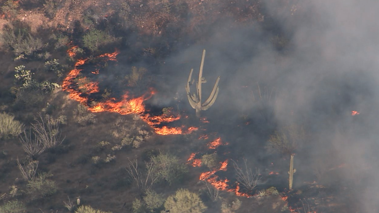 Residents near a town in south-central Arizona are the latest to evacuate as one of two wildfires, fueled by gusty winds and dry weather, grew overnight. Photo via Cliff Castle Chopper.