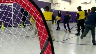Special Needs Students Play In Street Hockey Clinic