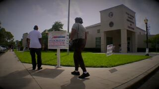 voters drop off ballots in drop box outside Palm Beach County Supervisor of Elections, March 5, 2021