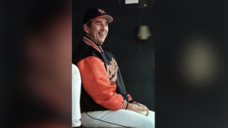 Baltimore Orioles manager Ray Miller, whose job is considered in peril as the team record stands at 6-16, smiles in the dugout during the Orioles' 7-1 win over the Minnesota Twins at Camden Yards in Baltimore on Friday, April 30, 1999. (AP Photo/Nick Wass)
