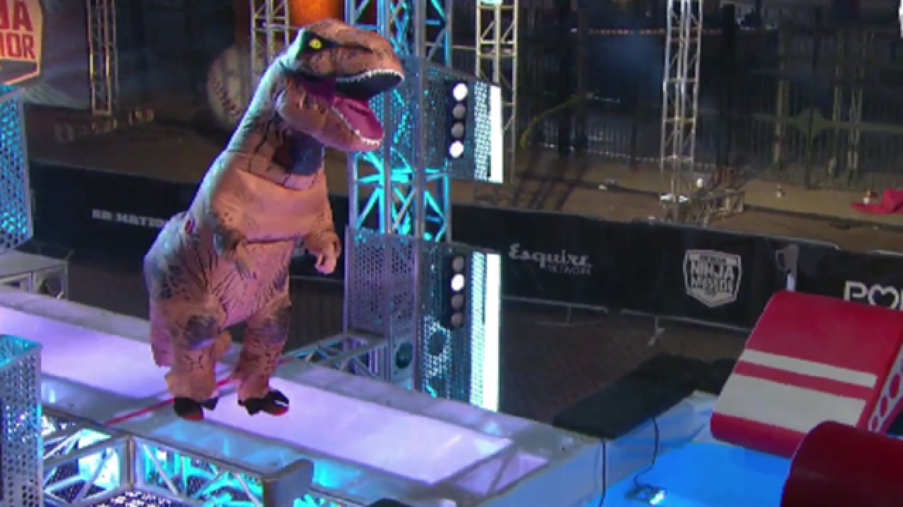 WATCH: Dressed as T-Rex, man competes on 'American Ninja Warrior'