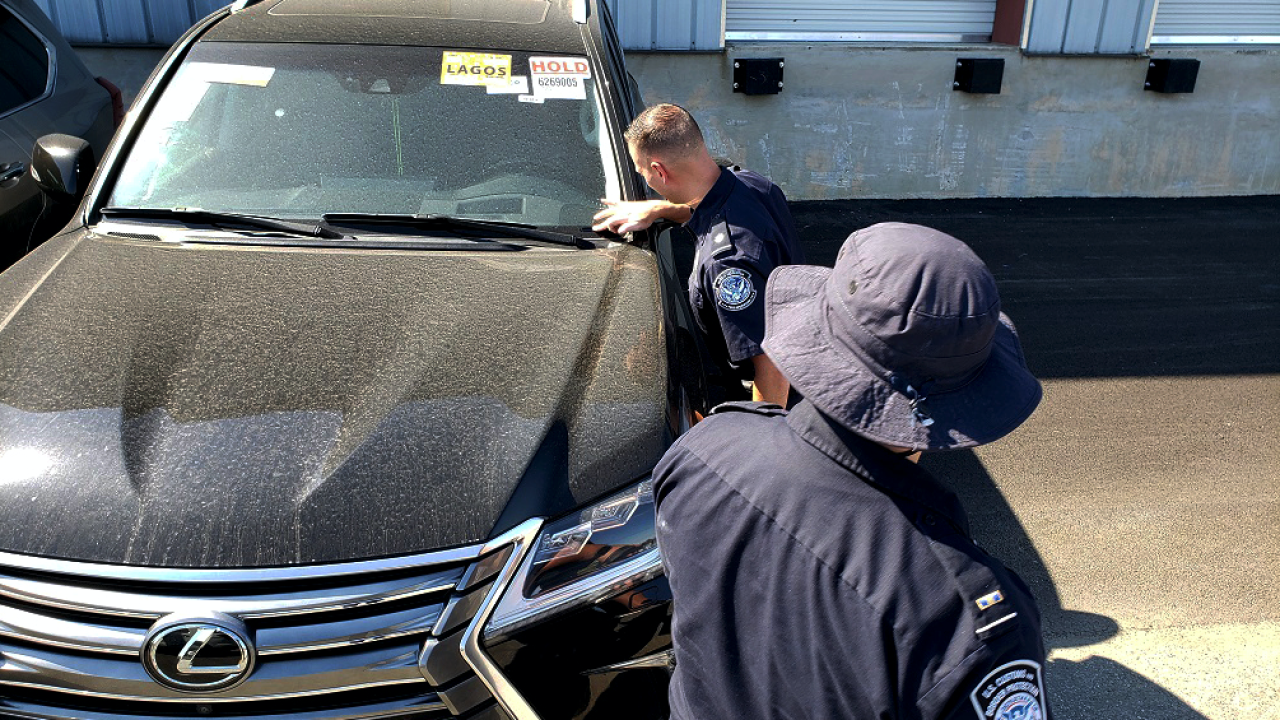 Customs and Border Protection officers at the Port of Wilmington examine a 2016 Lexus LX570 destined to Nigeria.
