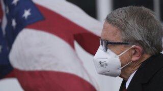 WCPO dewine in mask.jpeg