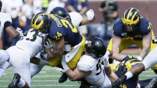 No. 7 Michigan holds on to beat Army in double overtime