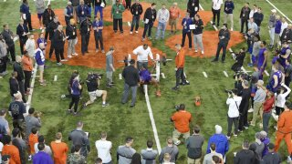 Clemson football player Tee Higgins lifts weights during NFL Pro Day
