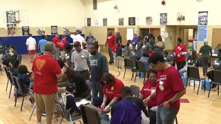 west baltimore students receive shoes