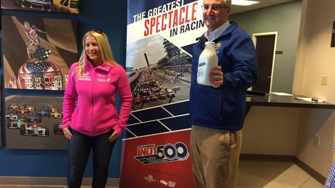 PHOTOS: Holcomb helps raise Indy 500 flag