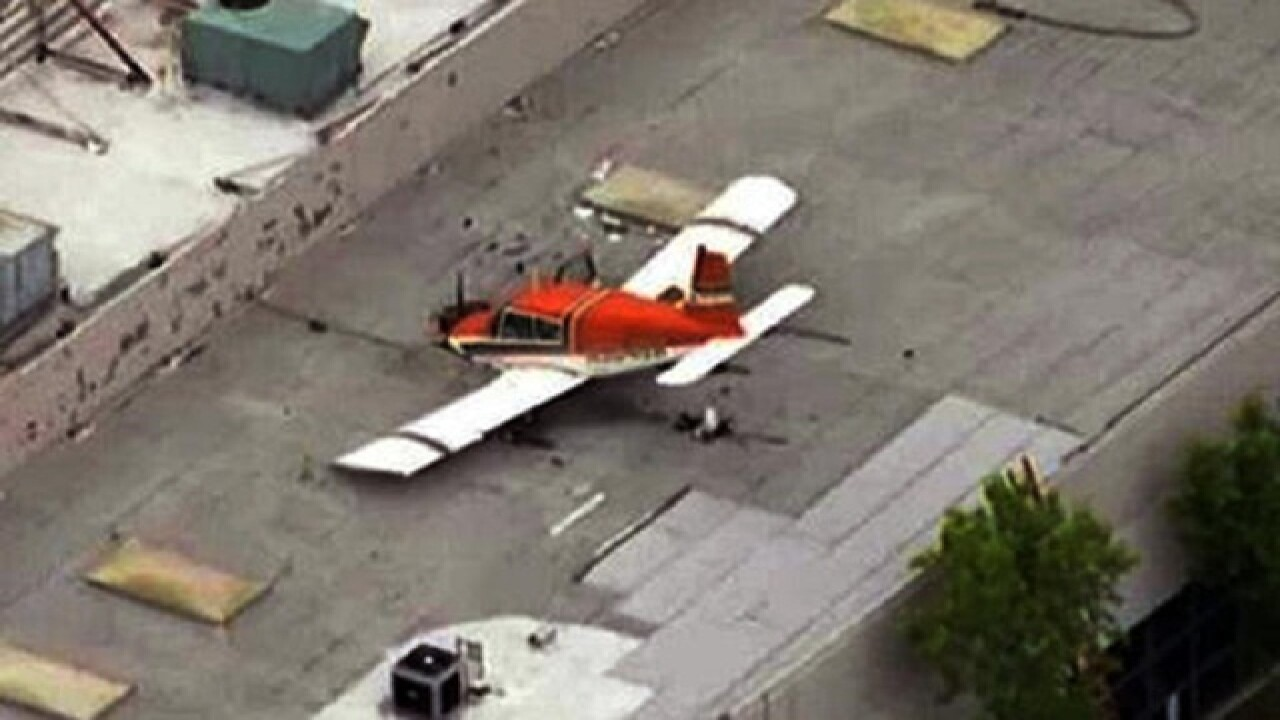 Small plane crashes onto roof of Calif  building