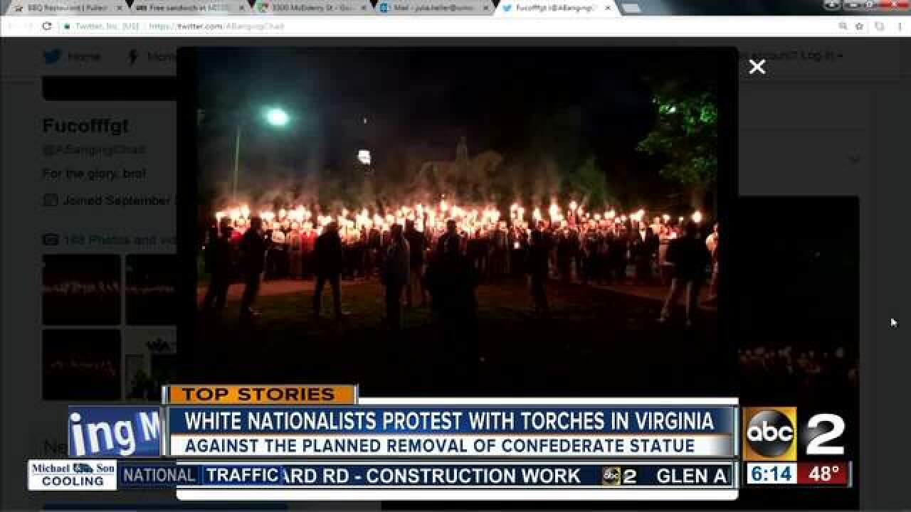 White nationalists carry torches to protest removal of confederate statue in Virginia