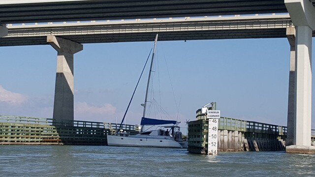 Sailboat stuck under the Marco Island Jolly Bridge