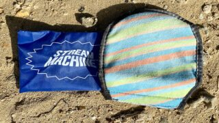 Brush Off Sand After A Day At The Beach With This Handy Mitt