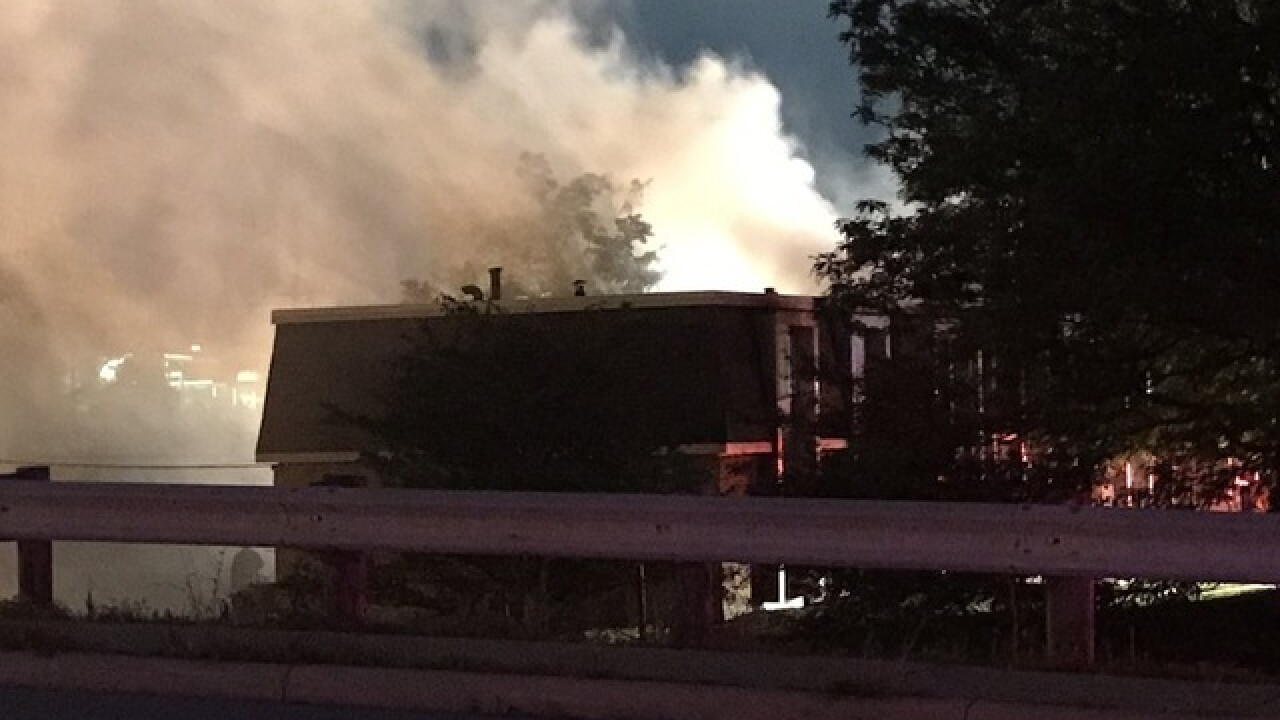 Cooking fire forces dozens from apartments