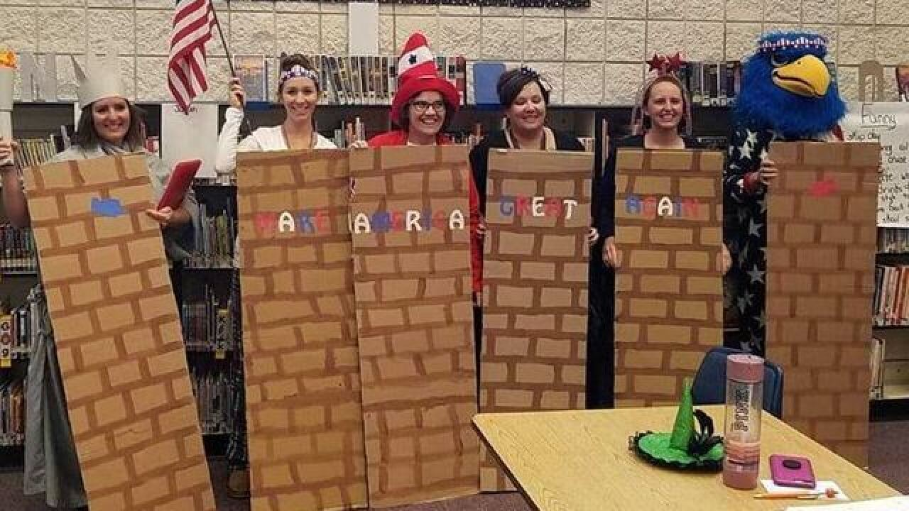 Teachers draw ire after dressing as border wall