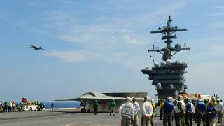 Photos: Navy tests unmanned X-47B with F/A-18s aboard the USS TheodoreRoosevelt