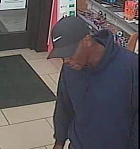 Photos: Police searching for suspect after convenience store robbed in Portsmouth