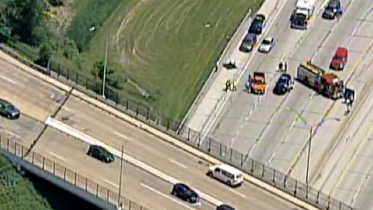 Man jumps off bridge onto I-480, hit by truck that flees scene