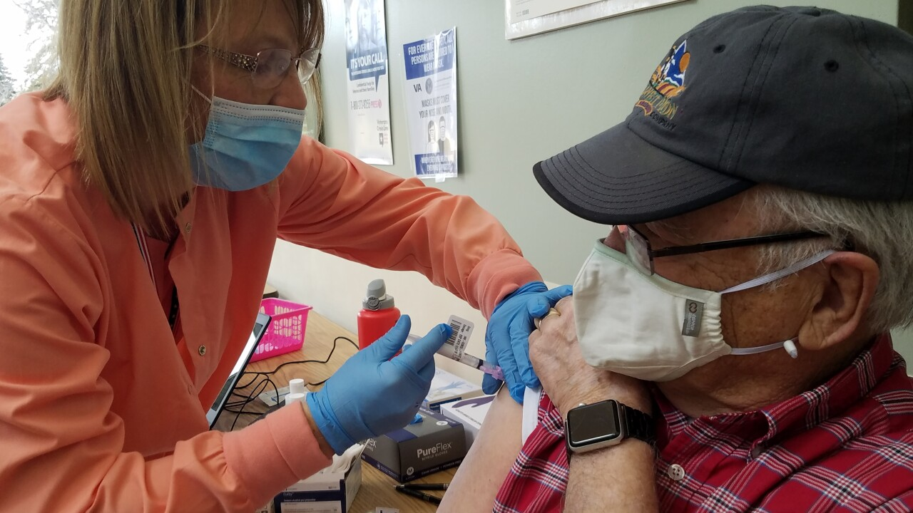 Montana veteran receiving first dose of COVID vaccine