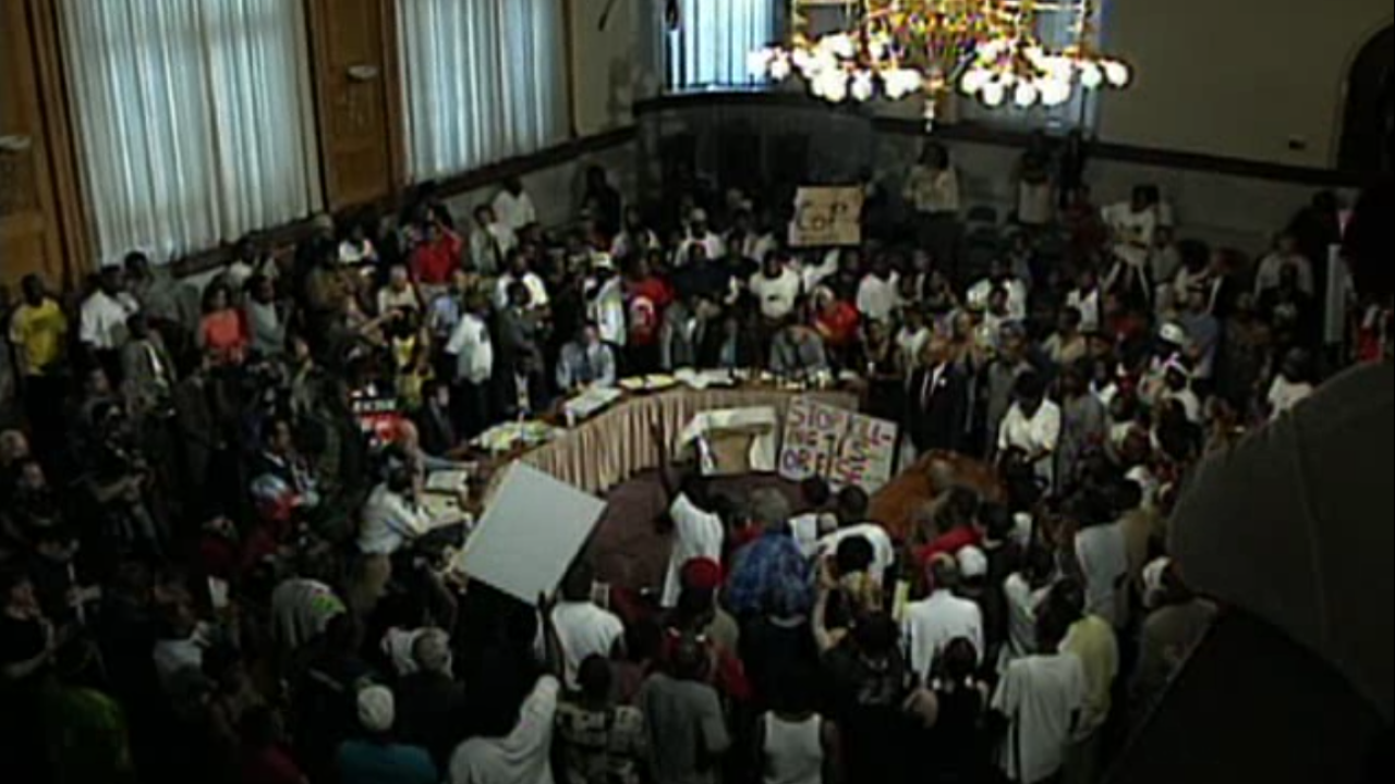 packed city council meeting.PNG