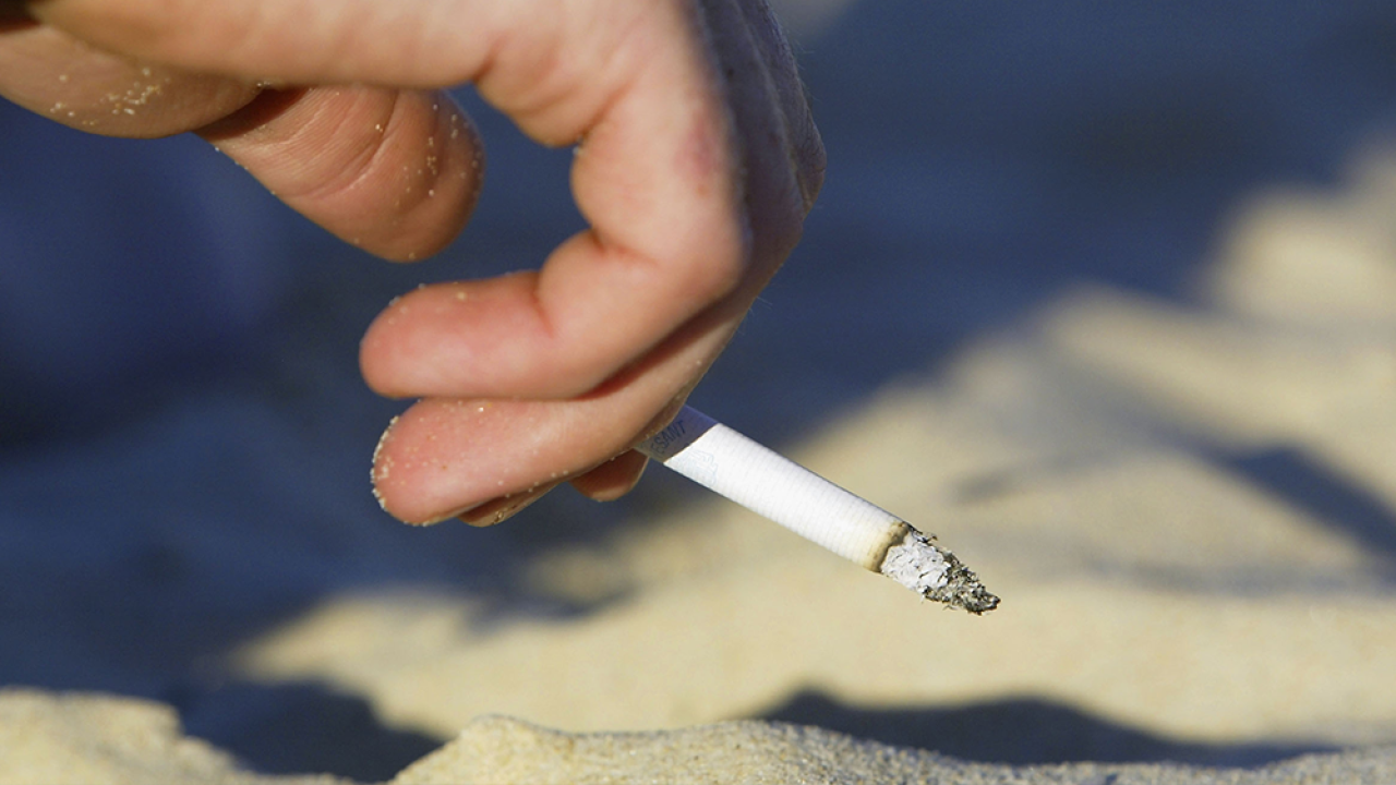 smoking-cigarette-on-beach.png