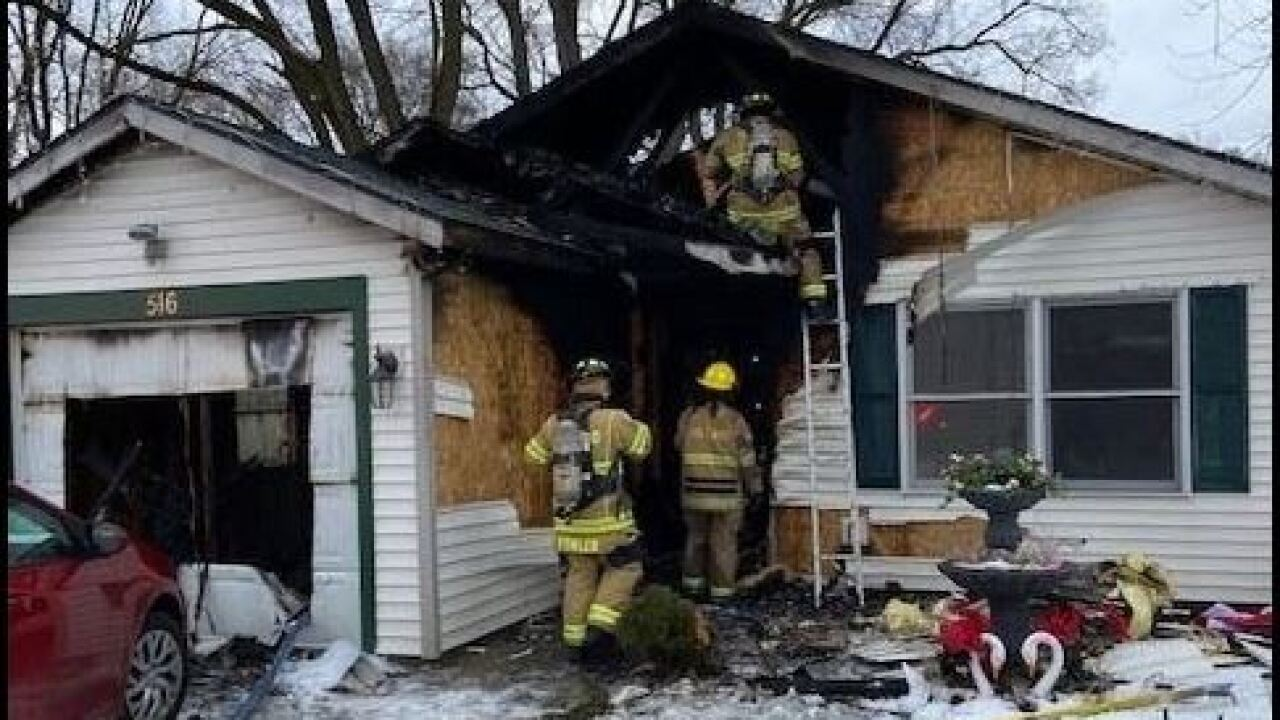 Firefighters enter burnt home of Holland Residence. Provided by City of Holland.