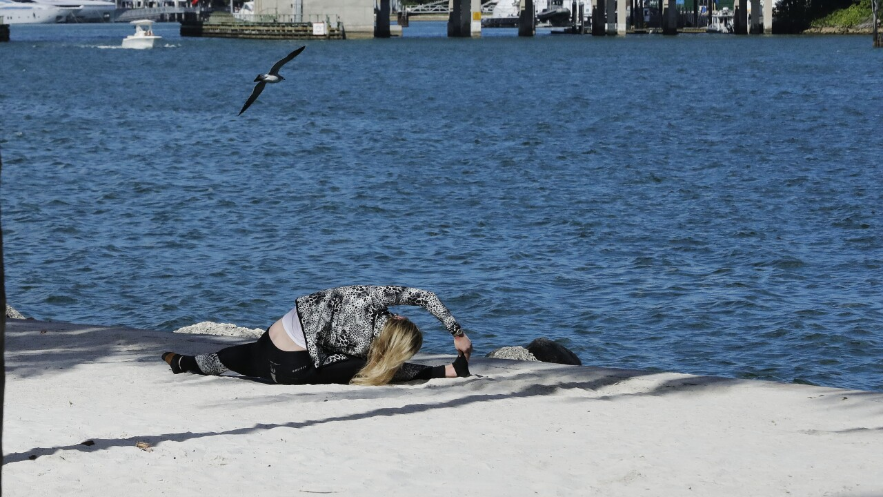 Woman works out near Biscayne Bay in Miami during coronavirus pandemic