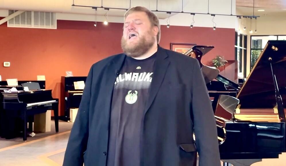 Ben Tajnai sings the national anthem