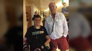 Former Elder basketball standout Ryan Custer with actor Bill Murray in 2017.