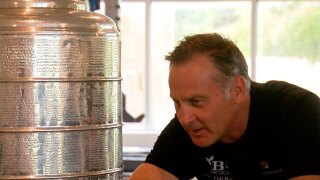Dr-Tim-Bain-and-Stanley-Cup-WFTS.jpg