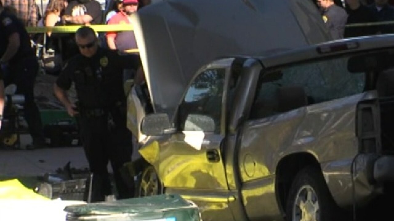 Driver arrested after truck lands on crowd