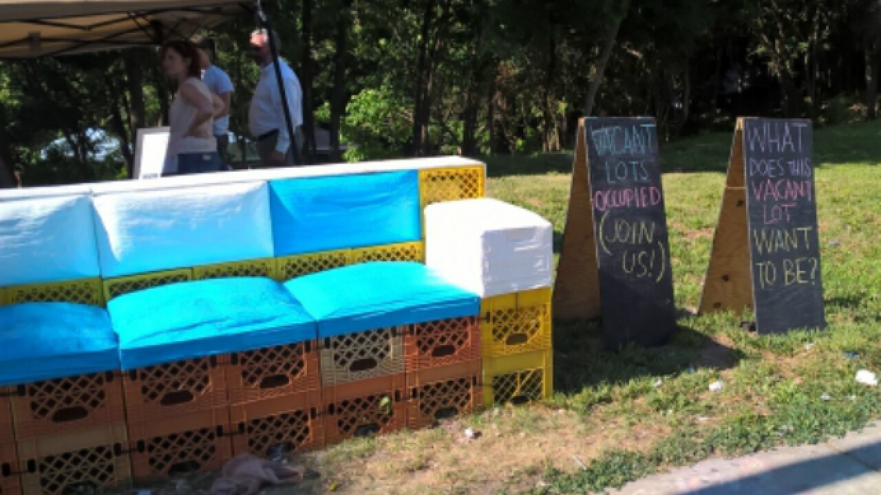 Students transform empty lot with milk crates