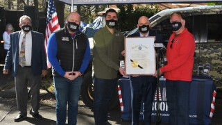 Governor honors Valor Roofing in recognition of their 'Raise a Roof for a Veteran' program
