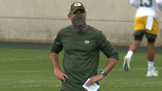 Matt LaFleur in mask at training camp practice